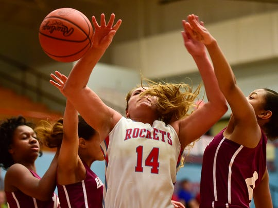 Ridgedale's Megan Mulvaine's attempt at a layup is stopped by Harvest Prep players during a Division IV sectional tournament game. Mulvaine earned All-Ohio honors for the second straight season this week