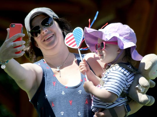 Kate Sirhal of Bremerton takes a selfie with her daughter Emma, 2, at the Tiny Town Fourth of July event at the Village Green Park in Kingston on Tuesday afternoon.