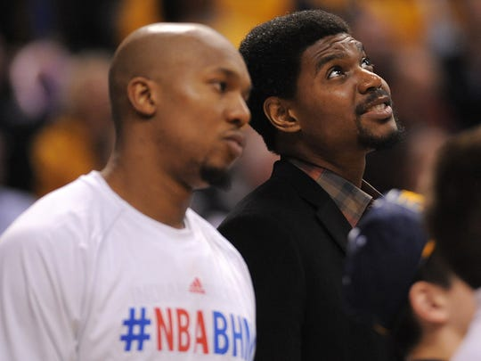Indiana Pacers center Andrew Bynum smiles while watching the St. Elmo's Shrimp Eating Contest during a timeout.