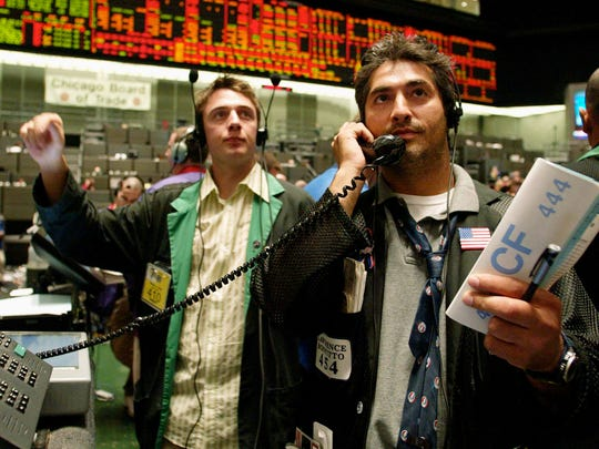 Traders in the 10-year Treasury note futures pit at the Chicago Board of Trade.