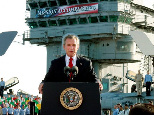 "President George W. Bush declares the end of major combat in Iraq aboard the aircraft carrier USS Abraham Lincoln in 2003, as a :Mission Accomplished"" banner appeared behind him."