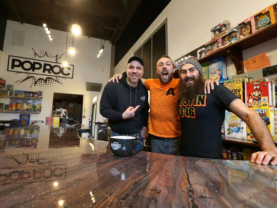 Co-owners Jason Hilton, left, Colin Delaney, middle, and Nick Andolina, right, pose behind the breakfast bar at POP ROC on East Ave. in Rochester Wednesday, April 4, 2018.