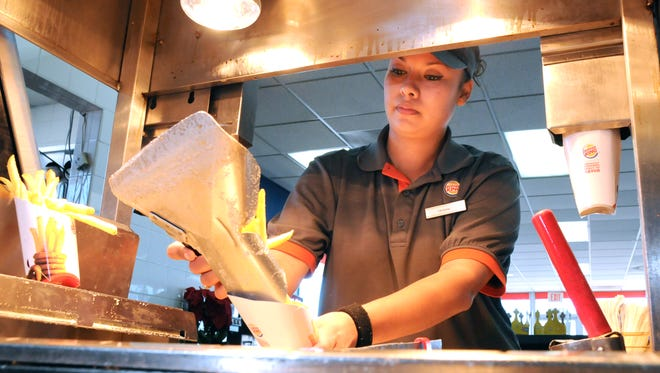 Vanessa Diaz was a cashier at Burger King in this 2013 file photo. Service and fast food workers were among those most affected by 2015's minimum wage increase to $8.40 per hour in Las Cruces. The next minimum wage increase will be to $9.20 in 2017.