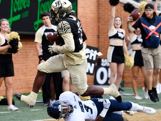 Wake Forest's Greg Dortch (3) runs a reception into the end zone for a touchdown as Rice's Jorian Clark (9) tries to defend during the first half of their NCAA college football game, Saturday, Sept. 29, 2018, in Winston-Salem, N.C. (AP Photo/Woody Marshall)