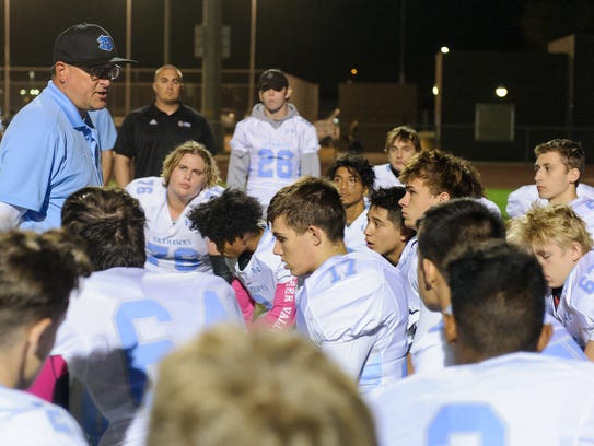 Ex-Deer Valley head coach Eric Bolus talks to his players after their high school football game against Desert Edge on Friday, Oct.20, 2017. Bolus resigned in December 2017.