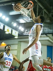 Delaware 87ers forward, Rodney Carney, slams the ball during a recent game against the Maine Red Claws at the Bob Carpenter Center.