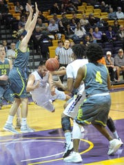 HSU's Duane Hopper, center, passes the ball to a teammate before falling to the court as Howard Payne's De'Marcus Hurd (4) and J Bailey defend. HSU won the American Southwest Conference West Division game 100-85 on Thursday, Jan. 12, 2017 at the Mabee Complex.