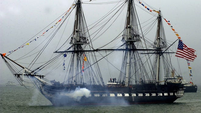 USS Constitution gives a gun salute during a celebration of the birth of the U.S. Navy as seen from Castle Island in the South Boston neighborhood of Boston., in this Oct. 11, 2003, file photo.