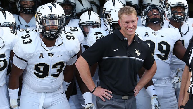UCF head coach Scott Frost leads his team to Miami to play Florida International on Saturday.