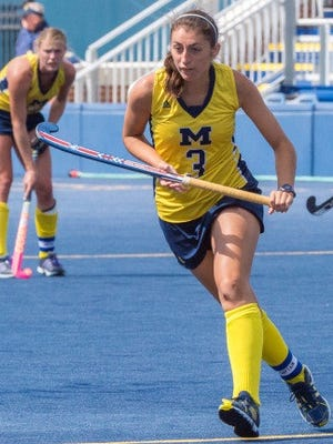 Lakeland graduate and Michigan field hockey senior Shannon Scavelli was the program's first-ever recipient of the Big 10's Medal of Honor.
