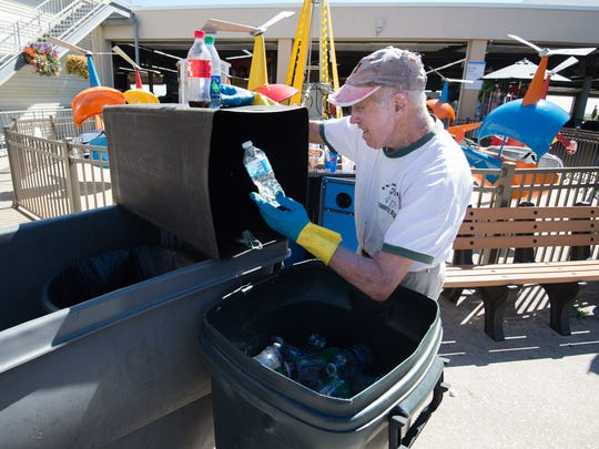 Al Fasnacht, co-founder of Funland in Rehoboth Beach, separates plastic bottles and aluminum cans for recycling.