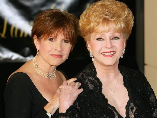 Actress Carrie Fisher (left) and her mother, actress