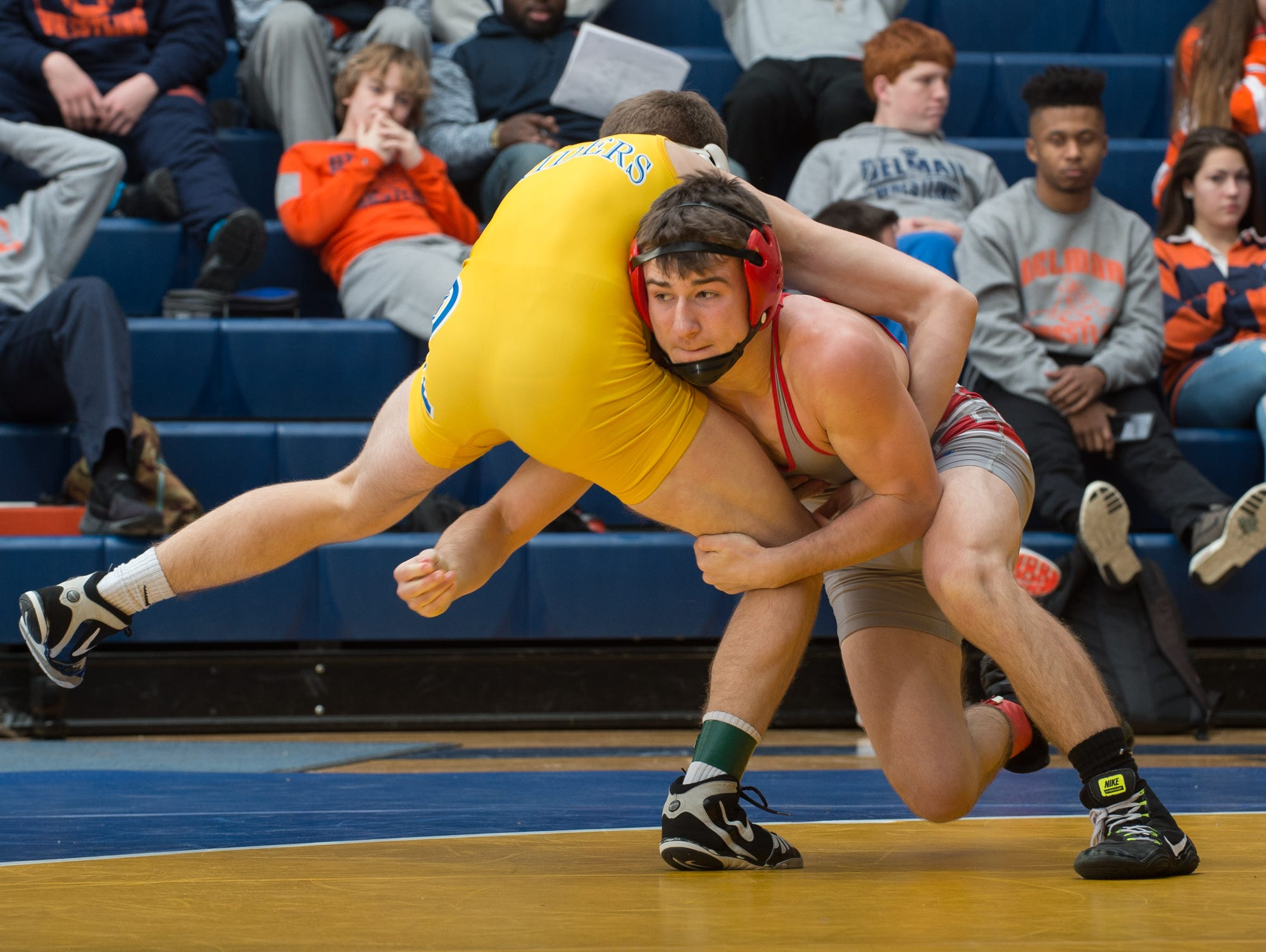 Smyrna's Greg Baum, right, wrestles Caesar Rodney's Jackson Dean in the 132 pound championship match at the Henlopen Conference wrestling tournament at Sussex Central High School.