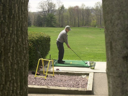 A golfer lines up his drive at the Town of Ramapo's