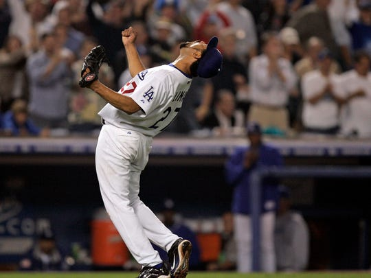 Los Angeles Dodgers starting pitcher Jose Lima reacts after the final out of the seventh inning of Game 3 of the National League Division Series against the St. Louis Cardinals on Oct. 9, 2004. (AP Photo/Mark J. Terrill)