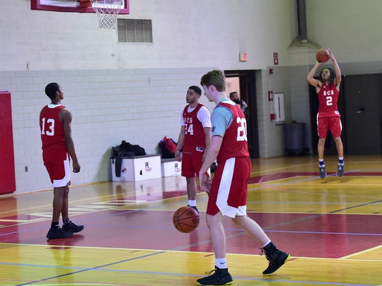 Teammates practice in the Scotland Campus Sports basketball team gym. The players were photographed at practice on Wednesday, December 6, 2017.