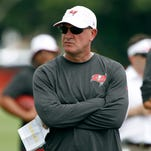 Buccaneers offensive coordinator Jeff Tedford watches play during training camp at One Bucs Place.