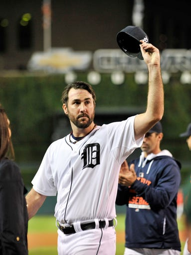 Tigers pitcher Justin Verlander waves his cap to the
