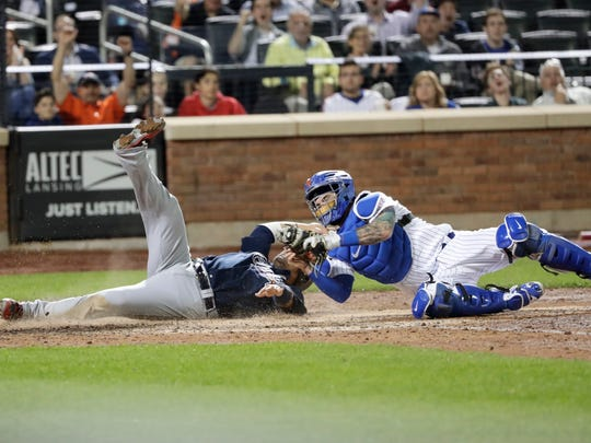 New York Mets catcher Tomas Nido tags out Atlanta Braves'