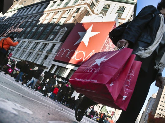 A shopper walks past the Macy's flagship store on 34th