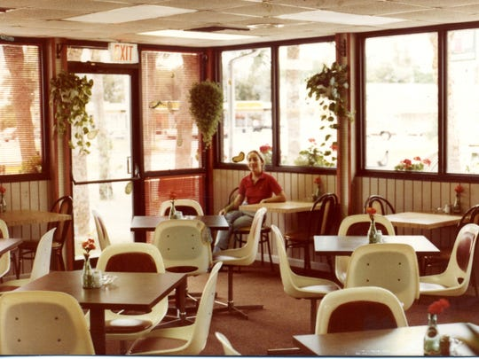 Co-owner Barbara Caron sits in the Rene's dining room shortly after the southern Fort Myers restaurant opened in 1981.