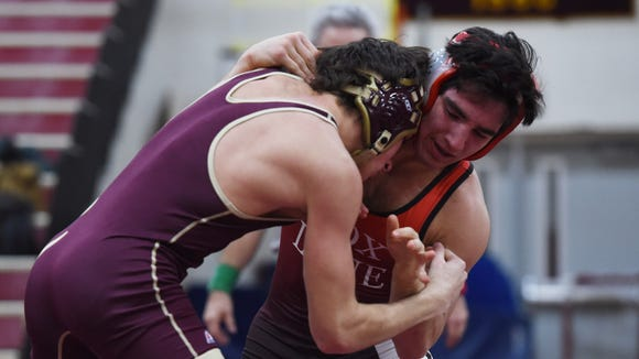 Fox Lane's Matt Grippi, right, wrestles Arlington's