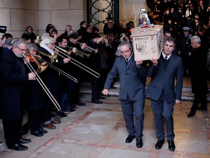 39 hebdo 39 victims buried as hollande calls for tolerance for Agence verlhac