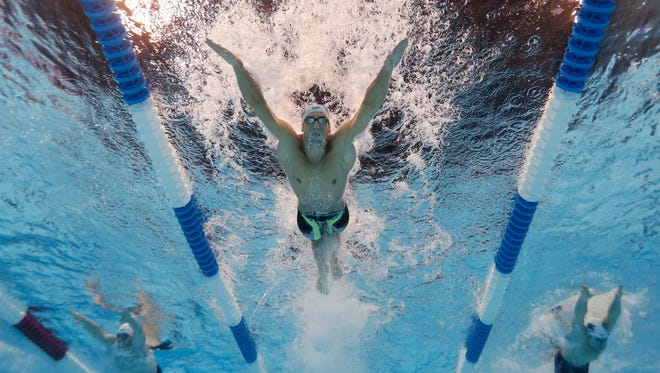 Michael Phelps led in 200 butterfly preliminaries Tuesday at the U.S. Olympic Swimming Trials, his first trials race.