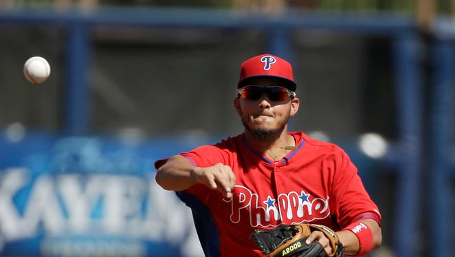 Philadelphia Phillies second baseman Freddy Galvis field the ball while working out on the field before an exhibition baseball game between against the Tampa Bay Rays, Monday, March 3, 2014, in Port Charlotte, Fla. The Rays beat the Phillies 6-1. (AP Photo/Steven Senne)