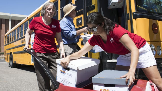 Alison Porter and Onida Perkel help unload on Aug. 8, 2017, more than 100,000 signatures to refer Arizona's controversial school-voucher expansion to the November 2018 ballot.