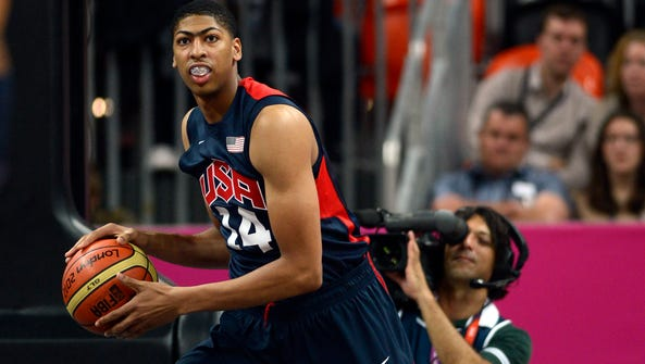 USA forward Anthony Davis holds the ball in the men's