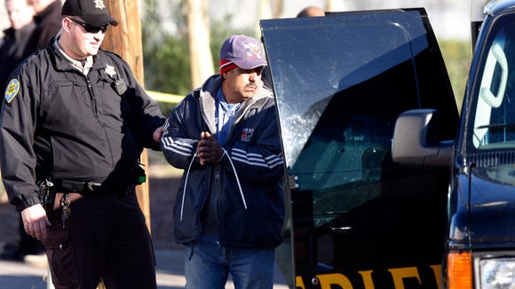 Maricopa County Sheriff's deputies conduct workplace raid.