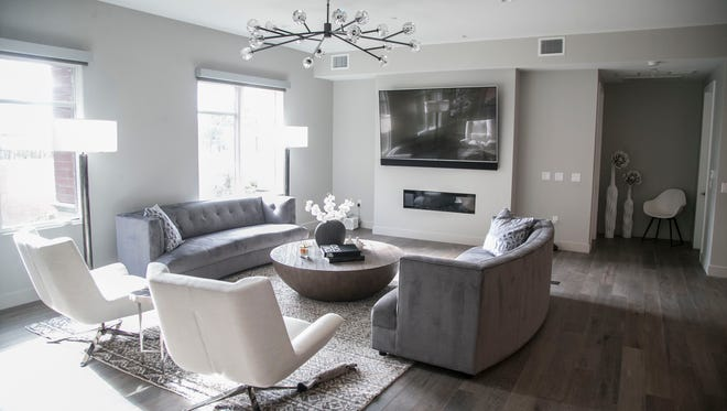 The living room in Lisa and Gregg Larson's home at the Enclave at Borgata luxury condos in Paradise Valley on May 9, 2017.