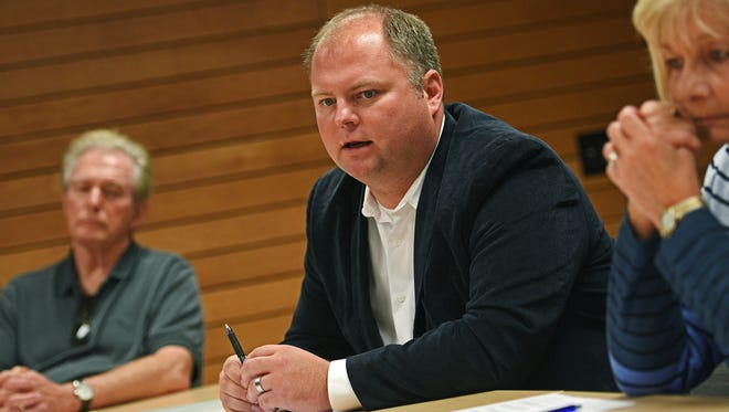 Richard Carlbom, with South Dakotans for Integrity, speaks during a press conference about Initiated Measure 22 Tuesday, Oct. 4, 2016, at the Downtown Branch of the Siouxland Libraries in Sioux Falls.