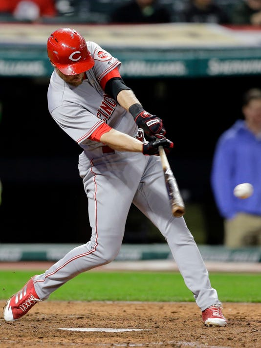 Cincinnati Reds shortstop Zack Cozart hits a two-run single off Cleveland Indians relief pitcher Cody Allen in the ninth inning of an interleague baseball game, Wednesday, May 24, 2017, in Cleveland. Arismendy Alcantara and Billy Hamilton scored on the play. The Reds won 4-3. (AP Photo/Tony Dejak)
