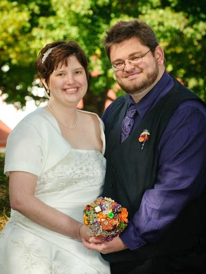 Kate Kompas (left) and Chris Shields pose on their wedding day on Oct. 1, 2011, in St. Cloud.