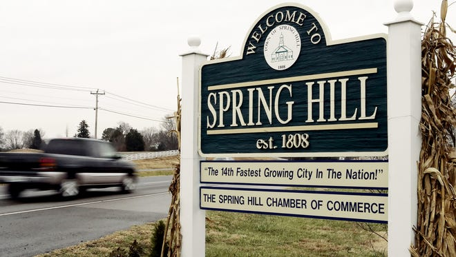 A welcome sign is shown at the city limits of Spring Hill.