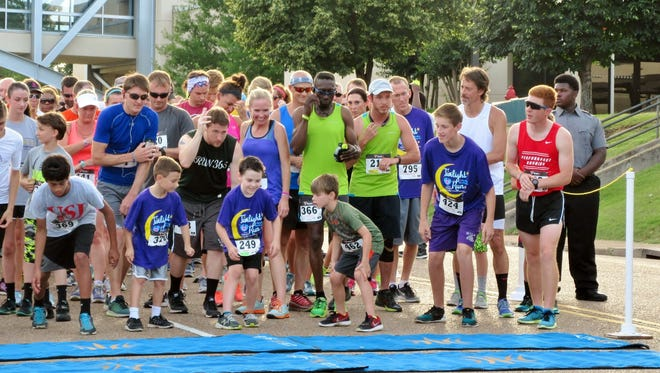 Participants crowd the start line Thursday at the fourth annual Heaven's Cradle Twilight Run and Rooftop Rendezvous.