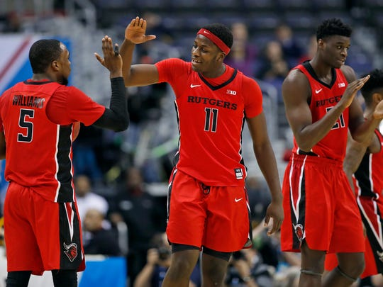 Rutgers guard Mike Williams, left, forward Eugene Omoruyi and forward Candido Sa celebrate during the last moments of the second half