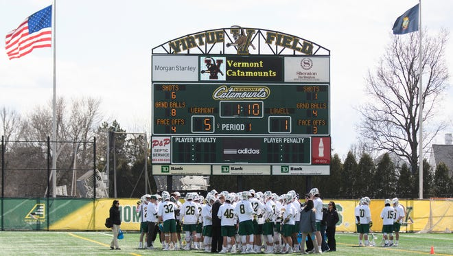 Vermont huddles together during the men's lacrosse game between there UMass Lowell Riverhawks and the Vermont Catamounts at Virtue Field on Saturday afternoon April 7, 2018 in Burlington. (BRIAN JENKINS/for the FREE PRESS)