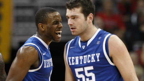 Kentucky's Josh Harrellson (55) is congratulated by