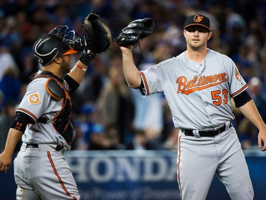 Baltimore Orioles closing pitcher Zach Britton (53) celebrates with Welington Castillo (29) after the Orioles defeated the Toronto Blue Jays in a baseball game in Toronto on Thursday, April 13, 2017. (Nathan Denette/The Canadian Press via AP)