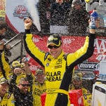 Matt Kenseth celebrates after winning the AAA 400 Drive For Autism at Dover International Speedway.