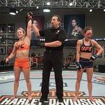 Bath native Amanda Cooper attempts to submit Lanchana Green during the filming of the The Ultimate Fighter at the UFC TUF Gym on March 1 in Las Vegas, Nevada. This semifinal fight, won by Cooper, aired last Wednesday. The win gave Cooper a berth in the championship fight, live this Friday night.