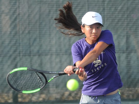 Abilene's Ruth Hill watches her return shot during an invitational tournament in June.
