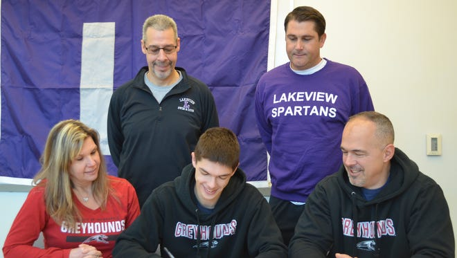 Lakeview diver Levi Youmans signs National Letter of Intent to compete for the University of Indianapolis. He is joined by his parents Kim and Robert Youmans and Lakeview coaches, back row, Willie English and Kyle Lott.