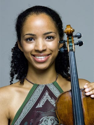 Violinist Anyango Yarbo-Davenport, an Eastman School graduate, won two international competitions at Carnegie Hall in 2010.
