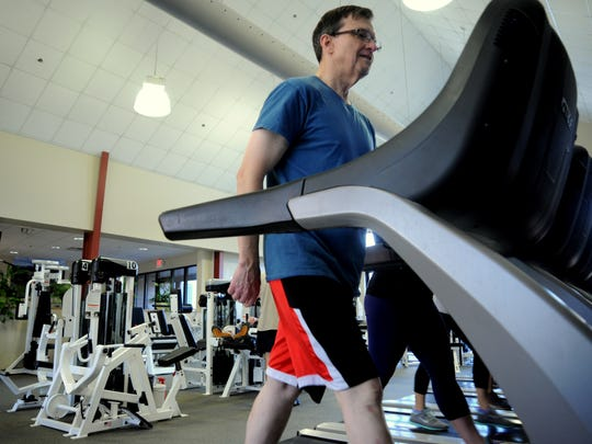 Richard Rockwell started working out regularly a year ago and continues to alternate between weight training and cardio exercise at Cheshire Fitness Club.