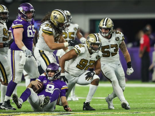Oct 28, 2018; Minneapolis, MN, USA; New Orleans Saints defensive end Marcus Davenport (92) celebrates his sack of Minnesota Vikings quarterback Kirk Cousins (8) with teammates during the fourth quarter at U.S. Bank Stadium. Mandatory Credit: Brace Hemmelgarn-USA TODAY Sports