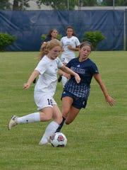 Marshall's Grace Townsend tries to get past a Gull Lake defender.